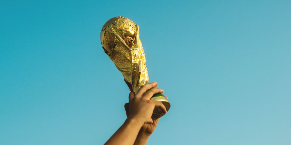a person holding a trophy.